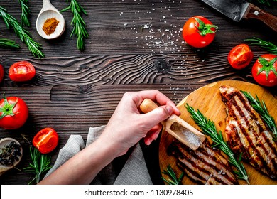 steak cooking with meat and spices on wooden background top view