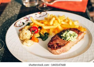 Steak Café de Paris with herb butter and french fries