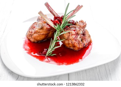 Steak entrecote pork with cherry sauce. Festive table for Christmas, festive New Year's dishes.