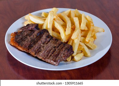 Steak with French fries. PERUVIAN FOOD