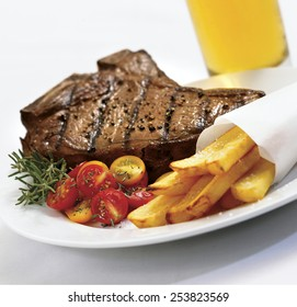 Steak and fries on white background
