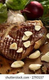 Steak with garlic - Shutterstock ID 2793157