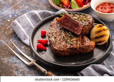 Steak - grilled beef steak. Fillet steak beef meat with  fresh salad, cherry  tomatoes and red pepper.
