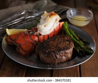 steak and lobster dinner in low key lighting