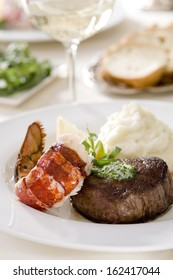 Steak and lobster with mashed potatoes.
