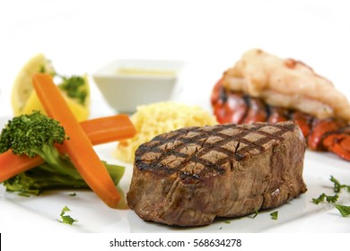 steak and lobster with vegetables
