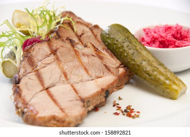 steak of meat with a cucumber and horse-radish