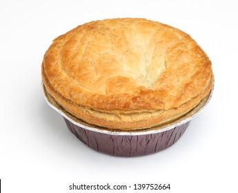 Steak meat pie in aluminium foil tray. Focus on centre of pastry top.