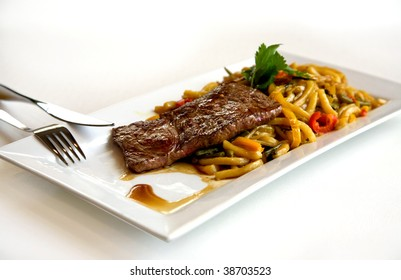 steak with noodles and vegetables