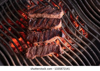 Steak on glowing charcoal