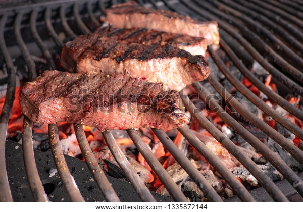 Steak on glowing charcoal