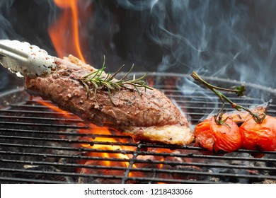 Steak on the grill with flames With Rosemary Pepper And Salt - Barbecue