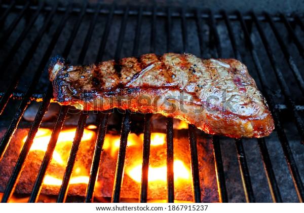 steak-on-grill-lighted-below-600w-186791