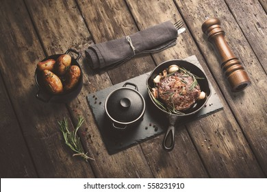 Steak on hot pan, with baked potatoes and sauce, with spices, isometric view with copy space