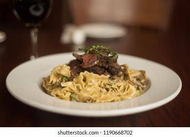 Steak on top of pasta