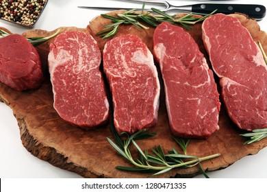 Steak raw. Barbecue Rib Eye Steak, dry Aged Wagyu Entrecote. Variety of Raw Black Angus Prime meat steaks Machete, Striploin, Rib eye, Tenderloin fillet mignon