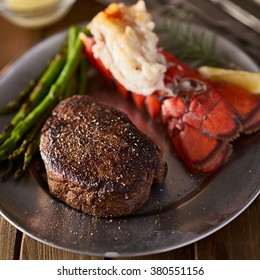 steak and seafood lobster dinner on plate