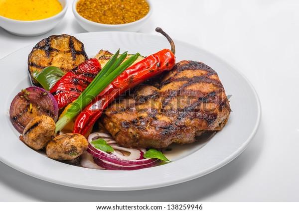 Steak seasoned with pepper and vegetables