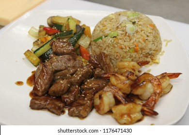 Steak and Shrimp Hibachi with vegetables and fired rice on a plate- Japanese Food