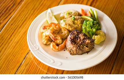 Steak and Shrimp with Mixed Vegetables and Baked Potatoes