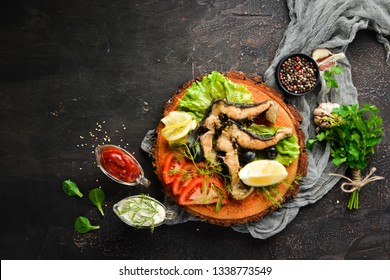 Steak sturgeon fish with vegetables. Barbecue. Top view. Free space for your text.