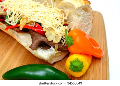 Steak and Sweet Pepper Sandwich with mild jalapeno chili and grated asiago cheese