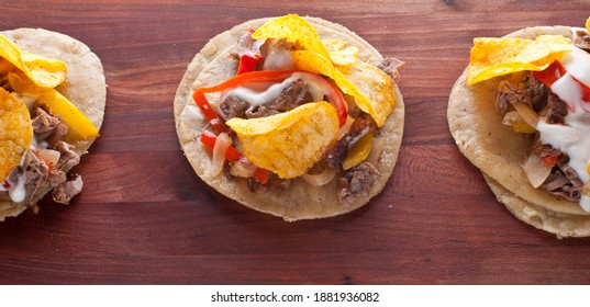 Steak Tacos. Tacos. Meat, fried fish, avocado, cilantro, cheese, homemade salsa, lettuce and lime slices. Tex-Mex favorite, Mexican street tacos: beef, fish, pork, served on homemade corn tortillas.