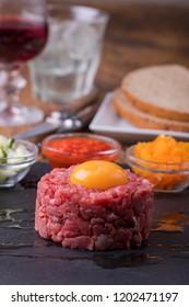 steak tartare with an egg on slate