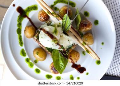 Steak tartare with ice herbs, parmesan, roasted potatoes and basil sauce