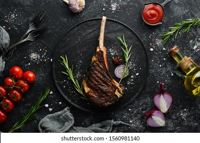 "Steak ""Tomahawk"" on the bone, grilled with rosemary and spices. Top view. Free space for your text."