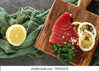 Steak of tuna for grilling. Dark background. Seafood