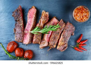 steak and vegetables on black plate