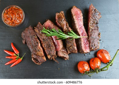 steak and vegetables on black plate