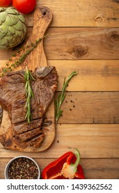 Steak with vegetables on a wooden background, restaurant and hotel business, menu, homemade recipes, culinary background, vertical photo, banner