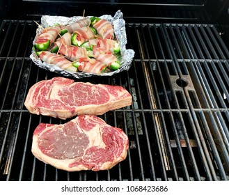 Steaks and food cooking on a Gas Grill