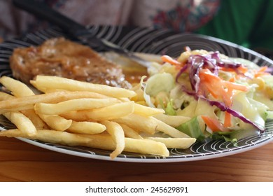 Steaks ,french fries with salad