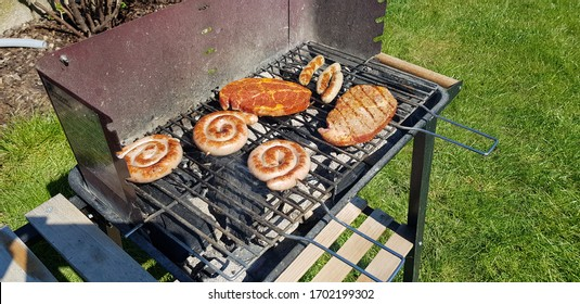 Steaks and sausage on a grill