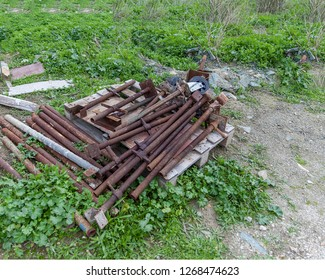 Steal Bars For Scaffolding .  Isolated.  Constructive old rusty steal bars left in a field. Stock Image.