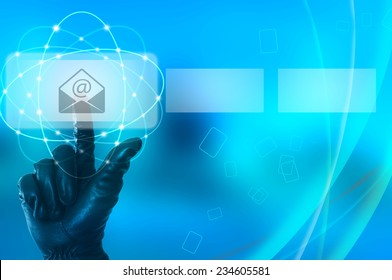 Stealing e-mail data concept with hand wearing black glove touching a virtual screen