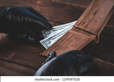 Stealing money from a wallet. Theft concept.
