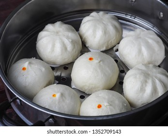 Steam bun or Bao, a famous traditional cuisine in asia. Selective focus.