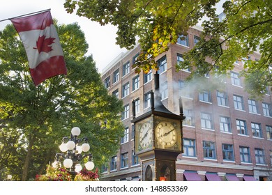 Steam Clock at Gastown Vancouver BC Canada with Canada Flag in the Morning with Sunlight