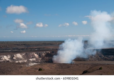 Steam colored pink by hot lava rises from volcanic crater in Hawaii.