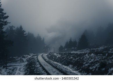 Steam comes out of the fog in the evening. Winter in the Harz national Park