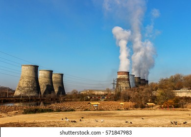 Steam comes out of the power plant cooling towers