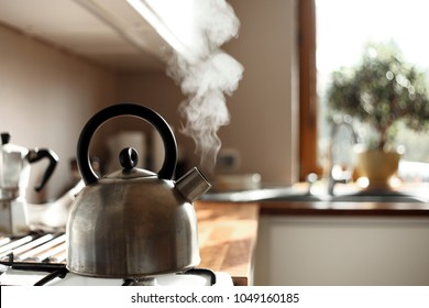 steam coming out of the kettle in the kitchen
