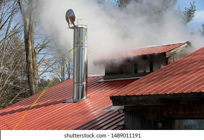Steam coming from stack on Maple Sugar House in Vermont