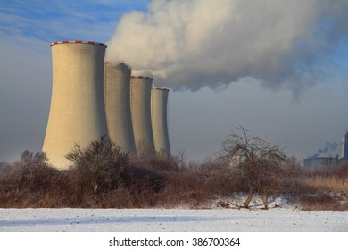The steam from the cooling towers of power plant.