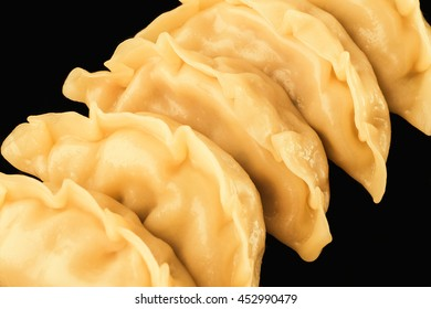 Steam dumpling  isolated on black plate on white background, Gyoza