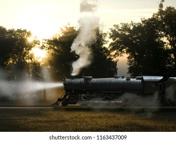 Steam Engine and Coal Car at Sunrise with Sunlight through Trees Markings Removed More Generic